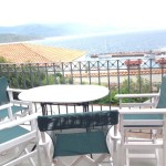 Veranda with sitting table and open view to the Aegean and to Molyvos Harbour